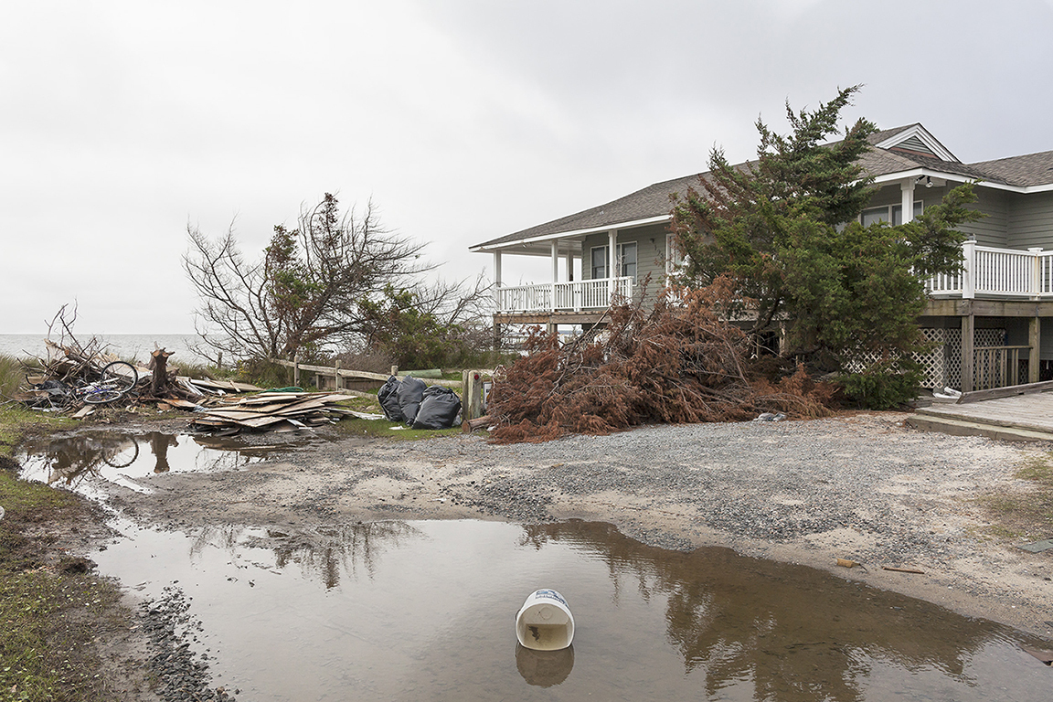 Beach House Damaged by Hurricane Dorian, 198 Pintail Drive, Ocracoke Island, North 	Carolina, 2019. Elevation Three Feet. N 35.11757 W 75.97319.