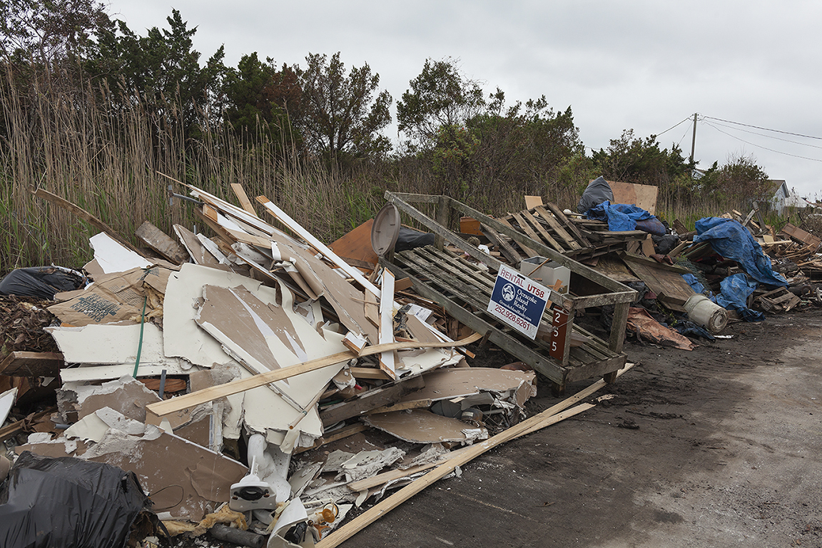 Debris from Hurricane Dorian, Irwin Garrish Highway, Ocracoke, North Carolina, 2019.   	Elevation Three Feet. N 35.09888 W 75.97092