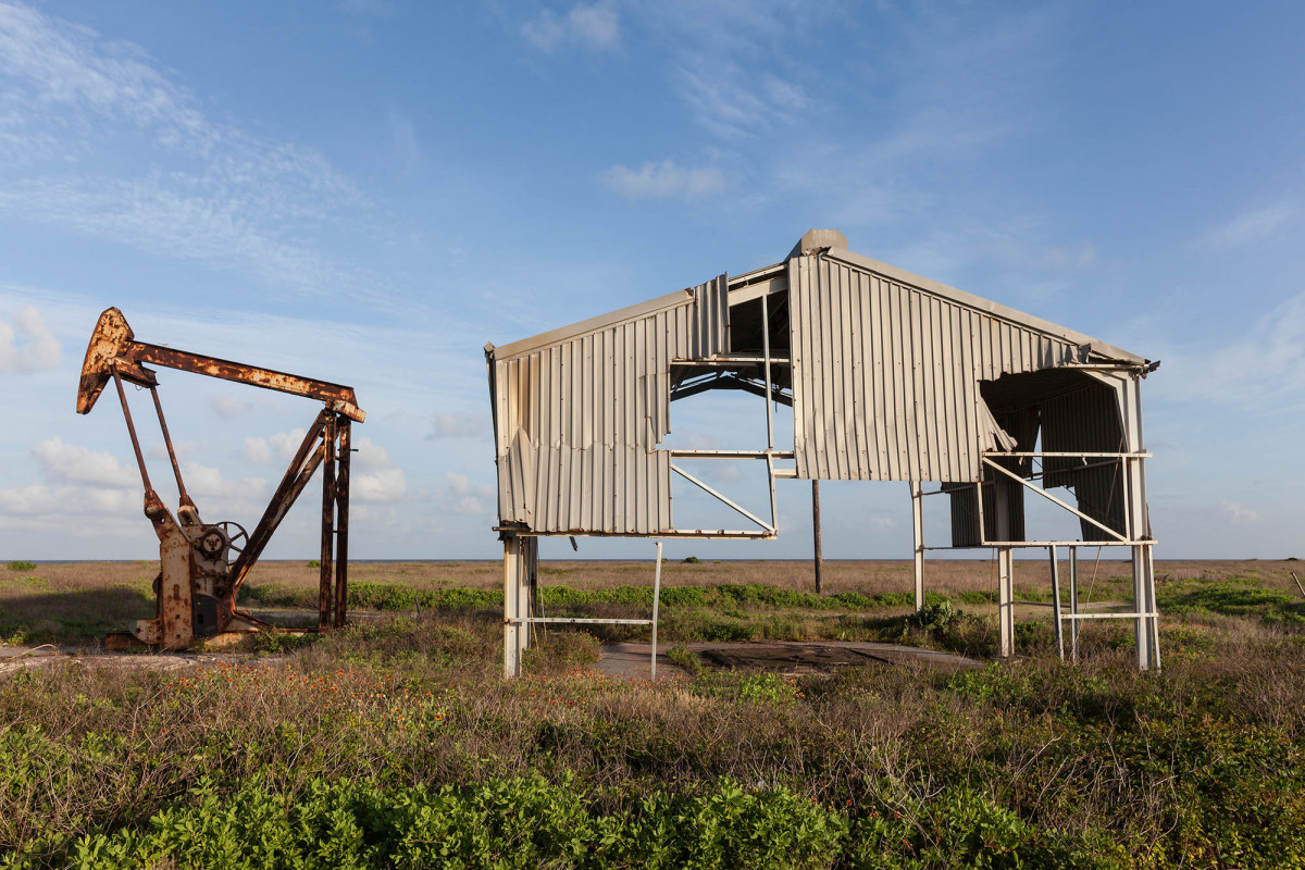 Derelict Oil Well and Building Damaged by Hurricane Ike, Bolivar Peninsula, Texas, 2014.