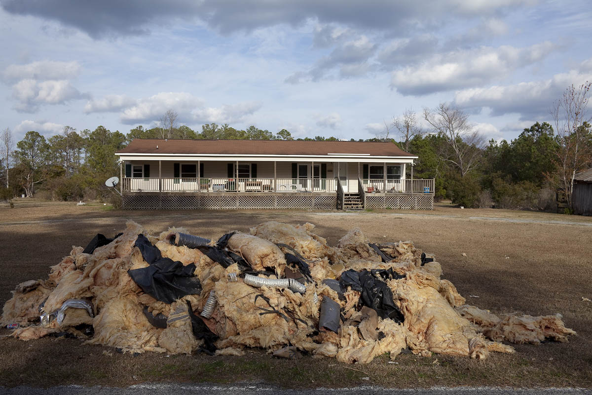 Water-damaged Home, with Insulation Removed after Hurricane Irene, Mesic, North Carolina,  2011.
